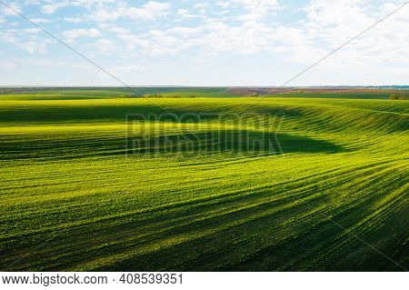 Splendid summer scene of a rolling hills of agricultural area from a bird's eye view. Ecology concept. Agrarian industry. Vibrant photo wallpaper. Location place Ukraine, Europe. Beauty of earth.