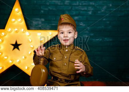 Happy Smiling Child Boy In Military Uniform. Young Soldier. Little Patriot. Army Thee Kid. Boy Playi