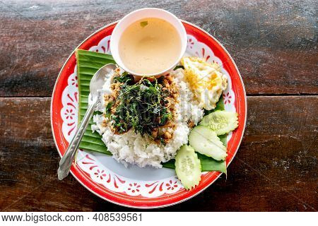 Rice Topped With Fried Pork, Basil, And A Fried Egg Fried Stir Basil Tray The Famous Dish Of Thai Pe