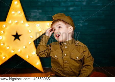 Little Patriot. Young Soldier. Army Thee Kid. Boy Playing Soldier. Portrait Of Happy Young Boy In Ca