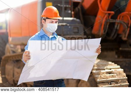 Architect site manager in a construction site, covid coronavirus construction concept