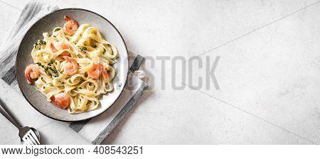 Shrimp Fetticcine Pasta. Italian Pasta With Shrimps And Cream Alfredo Sauce, Top View, Copy Space.