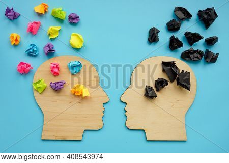 Negative And Positive Thinking Concept. Head Shapes With Color Paper Balls.