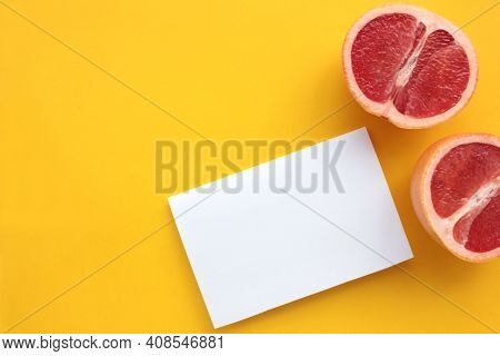 Summer Still Life With Half Of Grapefruit And Blank Paper Card.on Yellow Background. Invitation Mock