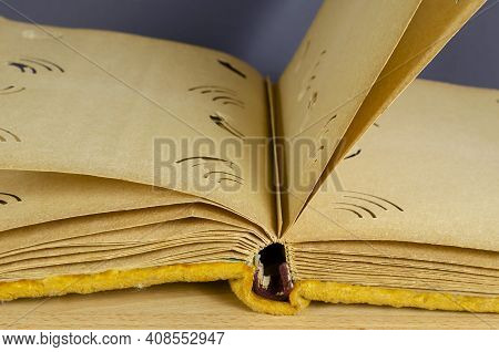 An Open Old Photo Album Wrapped In Yellow Velvet. Vintage Photo Album With Blank Pages Against A Gra