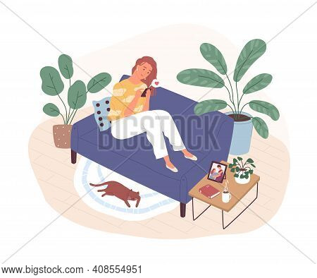 Young Woman Sitting On Couch At Home And Chatting Online In Dating App. Virtual Love Concept. Romant