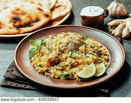 Pakistani Food - Biryani Rice With Chicken, Raita Yoghurt Dip And Naan Flat Bread. Delicious Hyberab