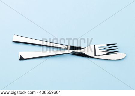 Fork and knife. Top view flat lay with copy space