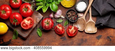 Italian cuisine ingredients. Garden tomatoes, herbs and spices. Top view flat lay