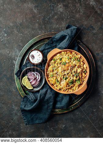Pakistani Food - Biryani Rice With Chicken And Raita Yoghurt Dip. Delicious Hyberabadi Chicken Birya