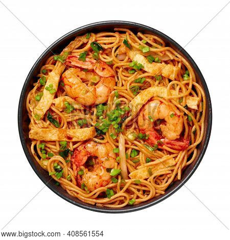Mie Goreng In Black Bowl Isolated On White. Indonesian Cuisine Prawn Noodles And Vegetables Stir Fir