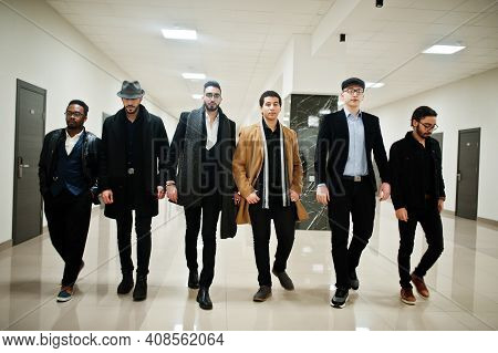 Group Of Handsome Retro Well-dressed Man Gangsters Indoor At Hotel. Multiethnic Male Bachelor Mafia.