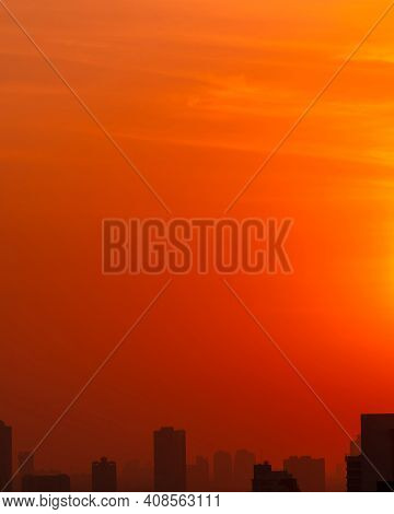 City In The Morning With Red Sunrise Sky And Smog. Air Pollution. Cityscape With Polluted Air. Urban