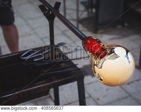 Glass-blower Artist Create White Glass Layer On Transparent Glass Bowl. Man Working With Hot  Glass