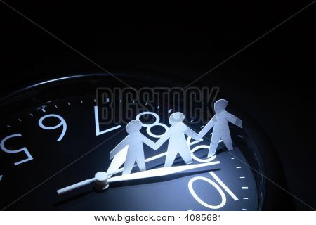 Papery Men On Clock