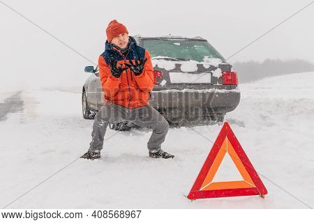 Close Up Man In An Orange Jacket Shouts, Jumps, And Gets Angry Near A Triangle Warning Sign Against