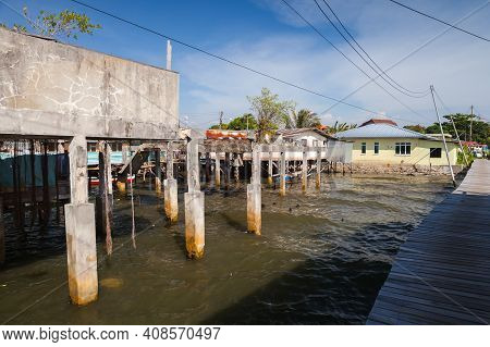 Coastal Street View Of Poor District Of Kota Kinabalu City, Malaysia. Small Living Houses, Abandoned
