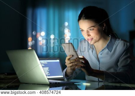 Entepreneur Working With Multiple Devices Late Hours In The Night At Office
