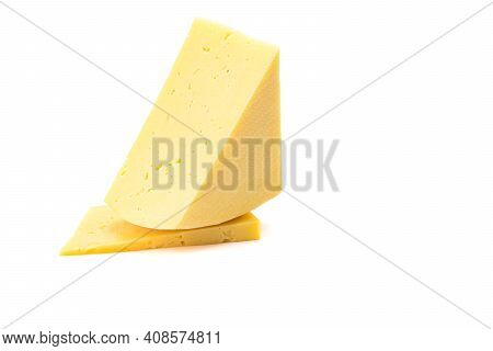 Solid Yellow Gouda Cheese, Close-up, Isolated On A White Background.selective Focus. Close-up.