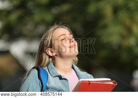 Happy Student Breathing Fresh Air Standing In A Park Or University Campus