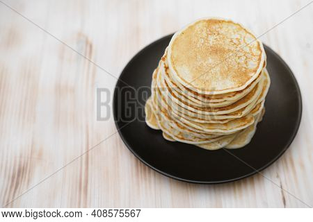 Stack Of Classic American Pancakes On A Wooden Table. Traditional Family Breakfast. Comforting Panca