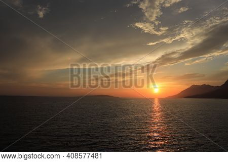 Fabulous Sunset Reflecting On The Waves Of The Flowing Mediterranean Sea In The Makarska Region Of S
