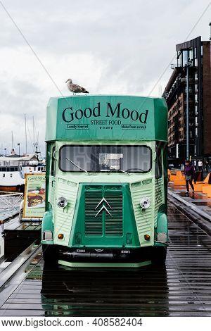 Oslo, Norway - August 10, 2019: Green Retro Food Truck Parked On Promenade In Aker Brygge
