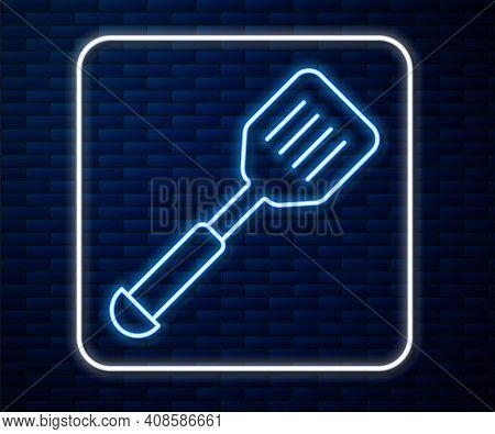 Glowing Neon Line Spatula Icon Isolated On Brick Wall Background. Kitchen Spatula Icon. Bbq Spatula