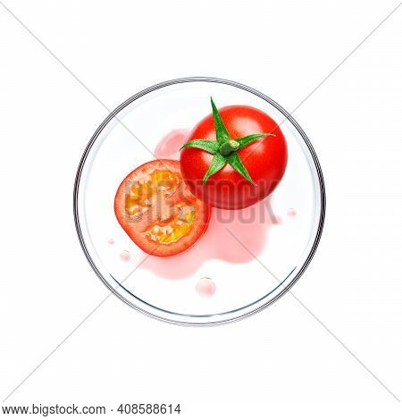 Red Tomato With Essence On Petri Dish Over White Background