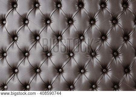 Decorative Upholstery Of Wall With Soft Interior Panels. Wall Furniture Upholstery In Dark Brown Lea