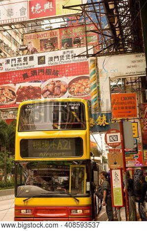 Hong Kong, China, Asia - December 03, 2008: Tourists Boarding A Bus To The Airport At Nathan Road, T