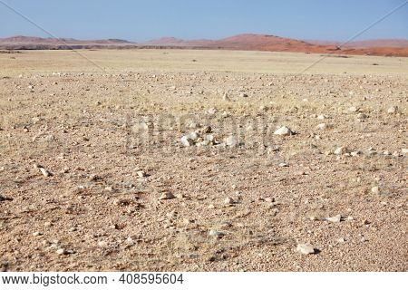 Orange sand dunes and stine desert of Namib Desert, Namibia, Africa