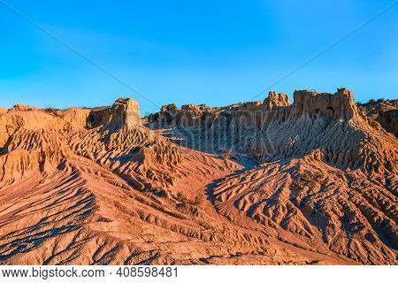 Clear Day At Mungo National Park In Australia. No Clouds And Classic Eroded Red Rock Formations
