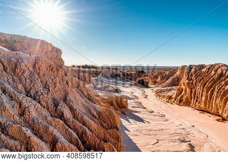 Texture And Landscape At Mungo National Park. Perspective Shot Of An Old Waterway Dried Out After Ye