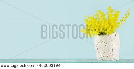 Mother Day Gift. Diy Ceramics Vase With Yellow Flowers. Isolated On Blue Background.