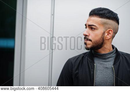 Portrait Of Stylish Arab Beard Man Wear Grey Turtleneck And Black Jaket. Arabian Model Guy Against S