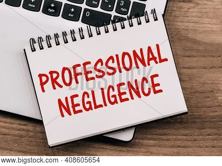 Professional Negligence - Inscription On Notepad On Laptop Keyboard.