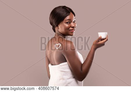 Love My Skin. Beautiful African American Woman Holding Jar With Moisturising Cream, Attractive Black