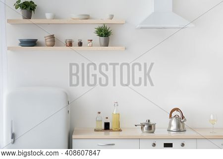 Modern Contemporary Kitchen Room Interior. White And Wood Material, Little Refrigerator, Stove With