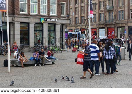 Amsterdam, Netherlands - July 10, 2017: People Visit Dam Square In Amsterdam, Netherlands. Amsterdam