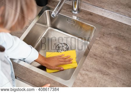 Woman Make Cleaning Kitchen Sink. House Cleaning