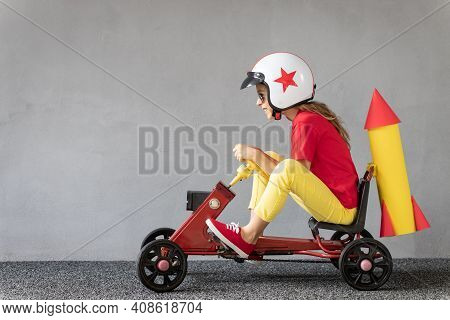Funny Kid Driving Racing Car. Success And Win Concept
