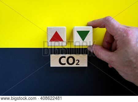 Co2 Changes Symbol. Concept Words 'co2' On A Wooden Block On A Beautiful Yellow And Black Background