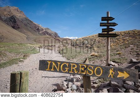 Directional Sign With Arrow Pointing Where Is Entrance On Hiking Trail In Aconcagua National Park, A