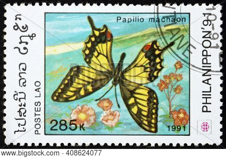 Laos - Circa 1991: A Stamp Printed In Laos Shows Old World Swallowtail, Papilio Machaon, Butterfly,