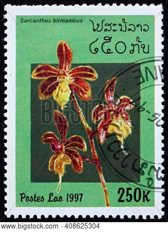 Laos - Circa 1997: A Stamp Printed In Laos Shows Sarcanthus Birmanicus, Is A Species Of Orchid, Circ