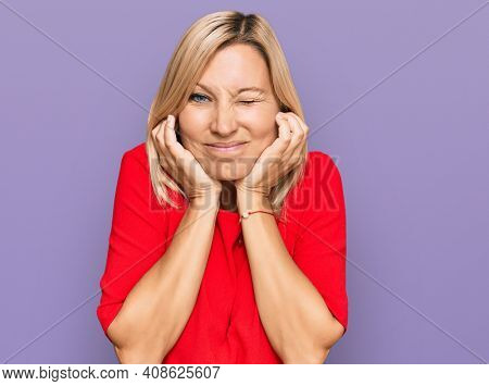 Middle age caucasian woman wearing casual clothes covering ears with fingers with annoyed expression for the noise of loud music. deaf concept.