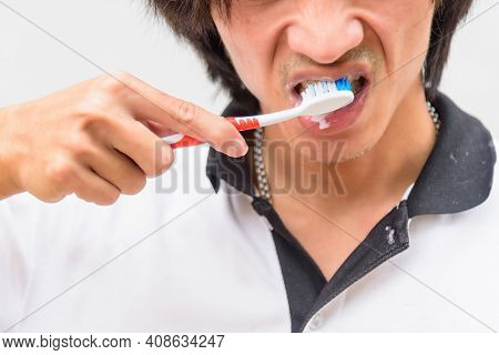 The Asian Man Has Brush Teeth In Morning Time
