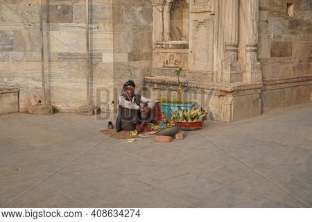Old Man Selling Corn On The Counter In A Touristic Area. An Indian Street Vendor Selling Roasted Cor