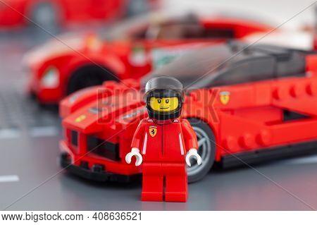 Tambov, Russian Federation - February 14, 2021 Lego Ferrari Driver Minifigure Standing Near His Lafe